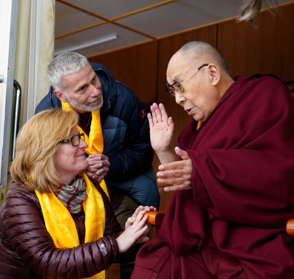 Enders and her husband with the Dalai Lama.