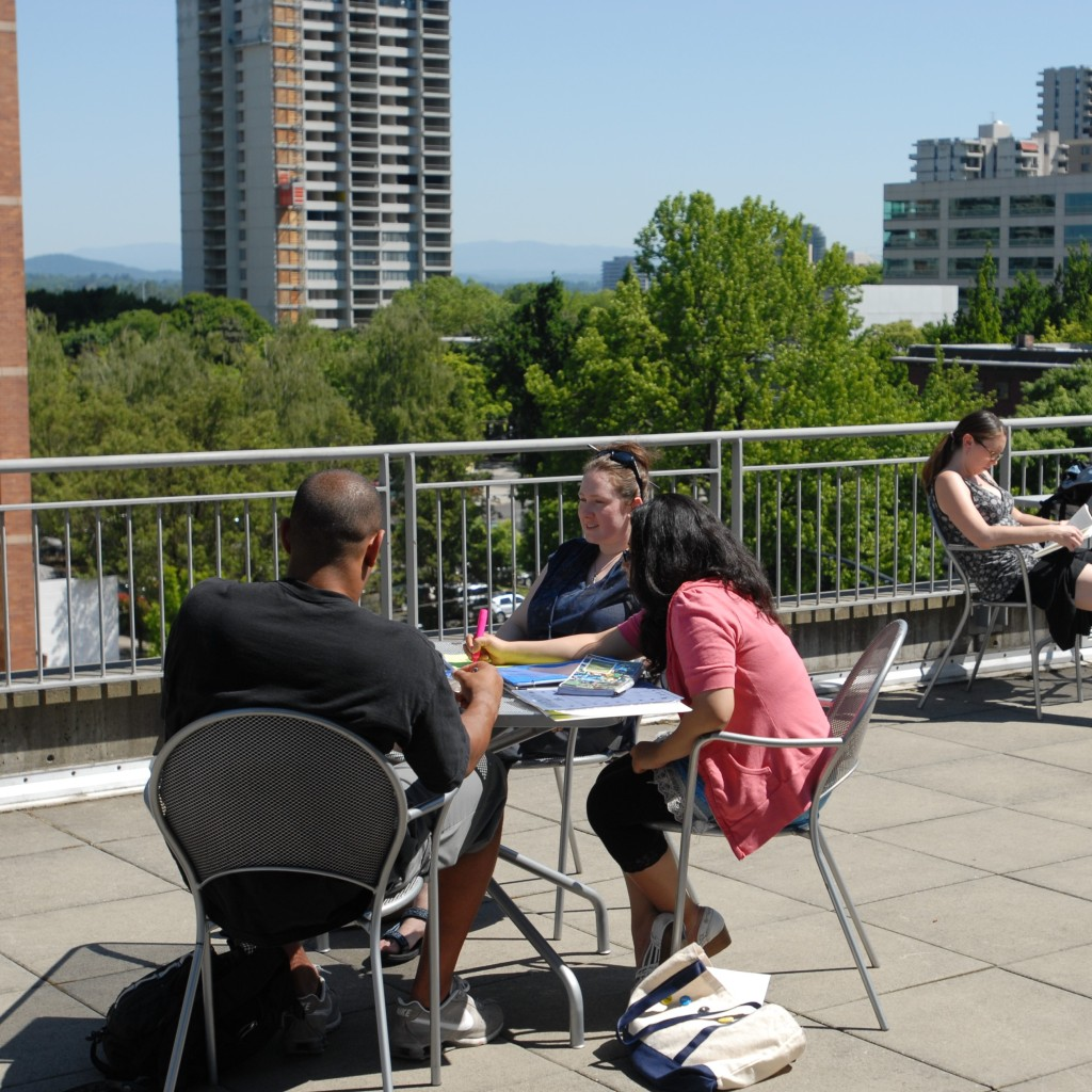 Student sitting on a Portland rooftop